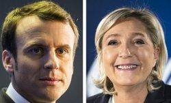 Экзит-полл: Во второй тур во Франции выходят Макрон и Ле-Пен