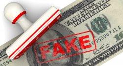 В Киеве ПриватБанк и полиция задержали фальшивомонетчиков